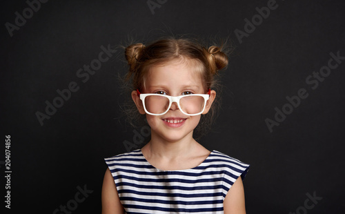 0d2e6c7c9d Studio portrait of cute girl wearing eyeglasses. Concept of vision, eye  care and correction