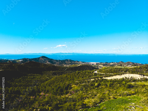 Poster Blauw Aerial view of lush European landscape and ocean