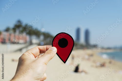 man with a red marker in La Barceloneta beach