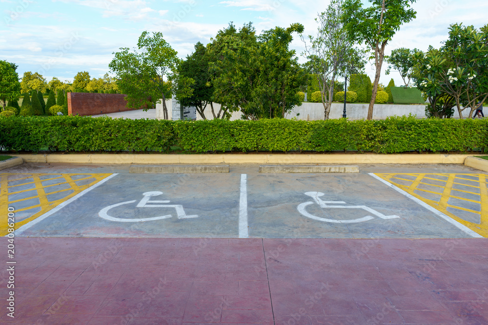Valokuva  Wheelchair sign at car park reserved for cripple person.