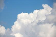 Fluffy Billowy Cumulus Clouds In The Blue Summer Sky In Florida