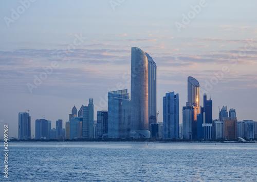 Skyline of the city center at sunrise, Abu Dhabi, United Arab Emirates