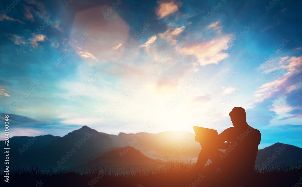 Fototapety, obrazy: Man sitting with a laptop outdoors in the mountains