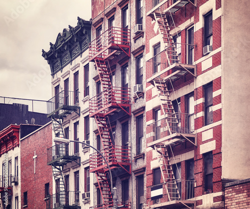 Foto op Canvas New York City Fire escapes, one of the New York City symbols, color toned picture, USA.