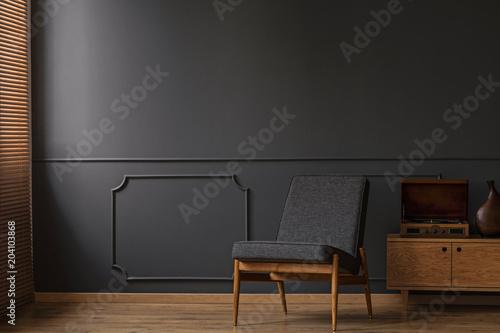 Obraz Armchair on empty wall - fototapety do salonu