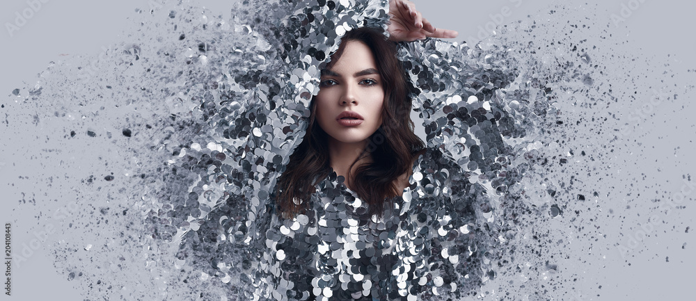 Fototapeta Beautiful brunette woman in fashion dress of sequins with dispersion effect