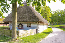Traditional Old Polish Countryside Wooden Thatched Houses And Farmyards.