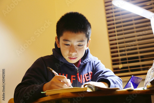 The boy study in the room