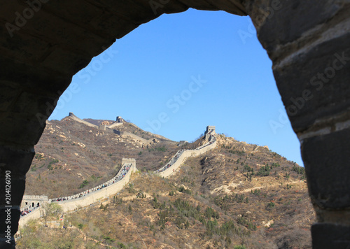 Deurstickers Chinese Muur Great Wall framed by an arc in Badaling, China. Unesco World Heritage Site. Defense, protection concept