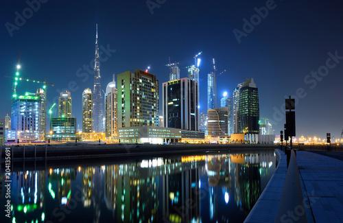 Dubai shopping center and khalifa at night