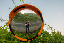 Using A Traffic Mirror As A Fisheye Lens For A Selfie On A Mountain Road