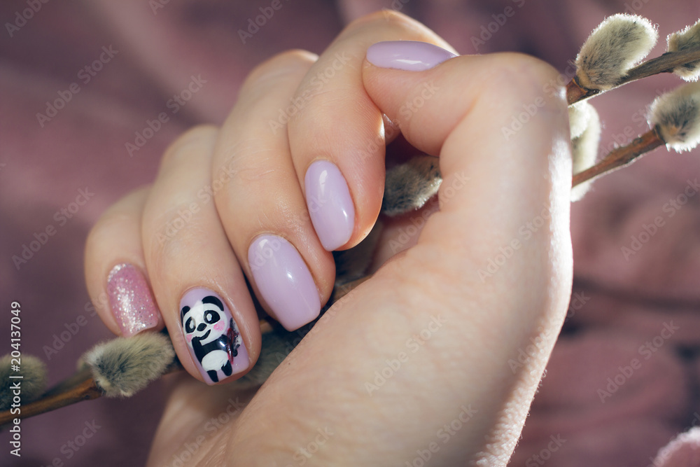 Manicure pastel color with a picture of a cute panda