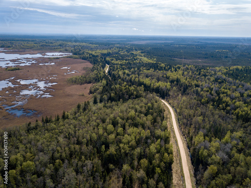In de dag Cappuccino drone image. aerial view of rural area with fields and forests and gravel roads seen from above