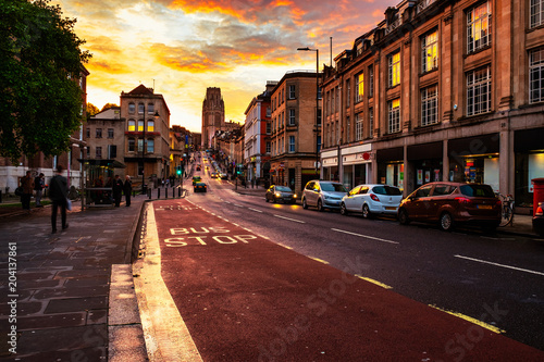 Famous street in the center of Bristol, UK in the evening during the colorful sunset