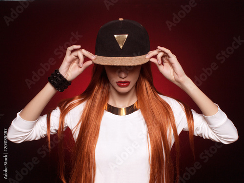 hip-hop girl in cap with long red hair Canvas Print
