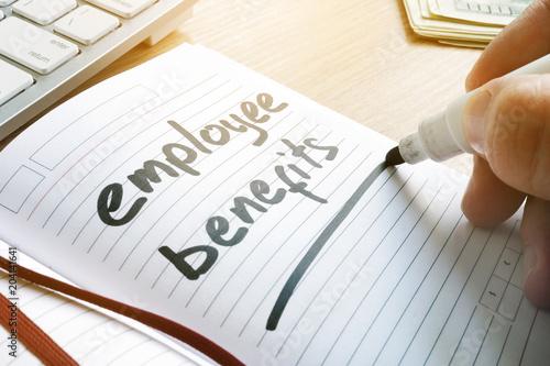 Fototapeta Hand is writing Employee benefits in a note. obraz