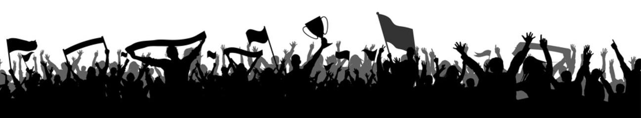 kibice z transparentami, flagami i Puchar