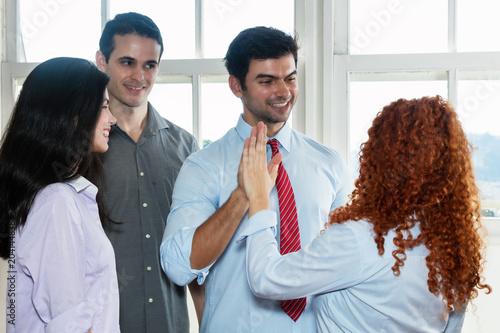 Fotografía  Laughing boss giving high five to employee