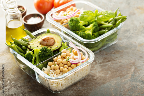 Fototapeta Vegan meal prep containers with cooked rice and chickpeas obraz