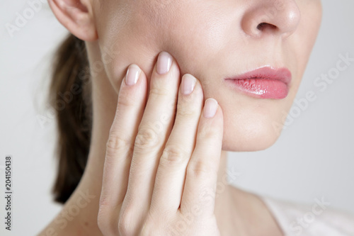 Studio shot of young woman with tooth pain, close up Canvas-taulu