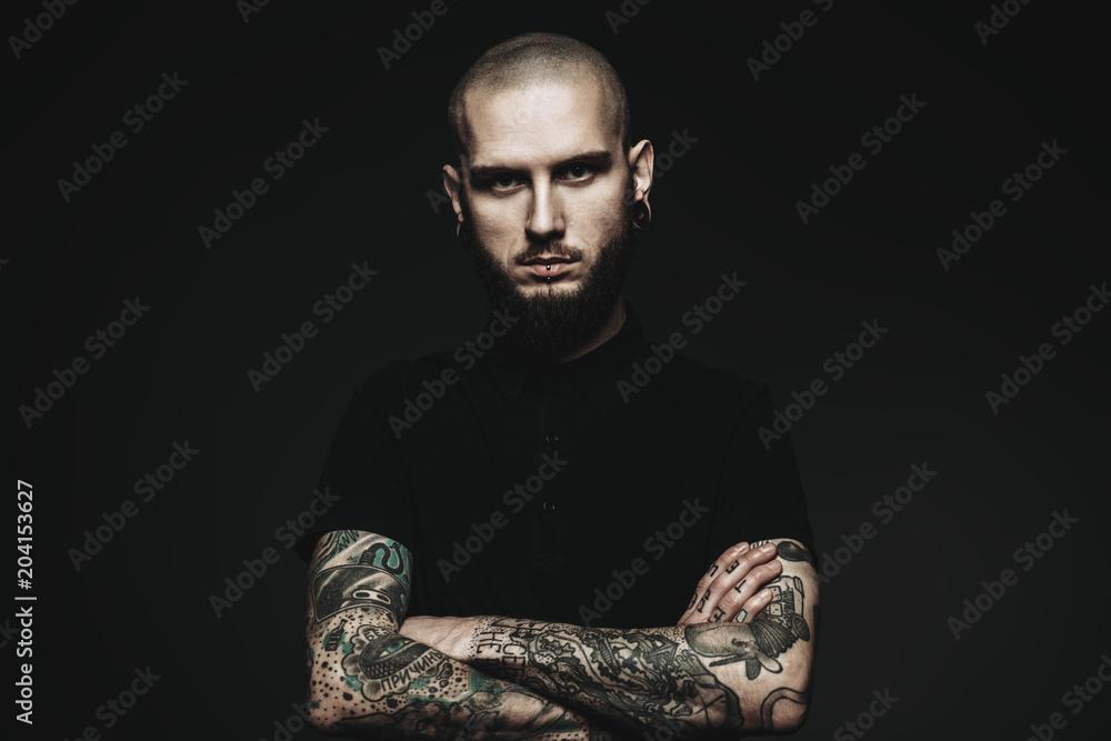 Fototapeta guy with tattooed hands