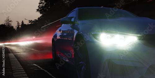 Obraz Scheinwerfer eines Sportwagens in der Nacht  - fototapety do salonu