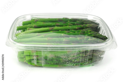 asparagus in plastic container isolated on white background