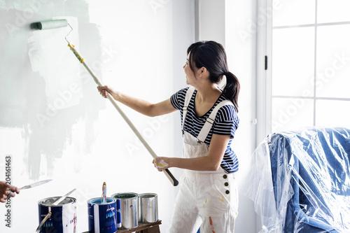Papiers peints Fluvial Asian woman panting house wall