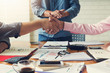 Business and finance concept of office working, Businessmans shaking hands in meeting room after meeting.