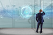 Businessman in front of a wall with connected earth globe concept icon on a futuristic interface