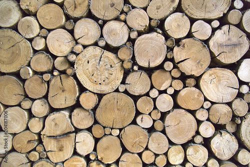 Fotoposter Brandhout textuur Sawn timber logs stacked for a wood burning stove. Close up in full frame and a horizontal format