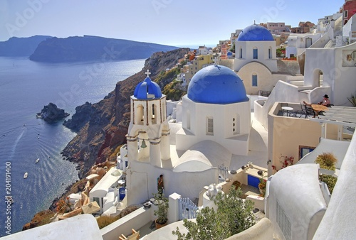 Townscape with churches on the hillside overlooking Caldera, Oia, Santorini, Thira, Cyclades, Aegean Islands, Aegean Sea, Greece, Europe
