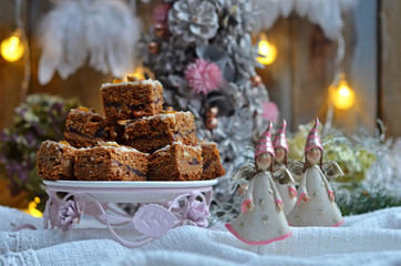 Pieces of gingerbread cake in a festive setting