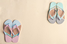 Colorful Flip Flops On Sandy Beach