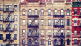 Vintage stylized picture of old buildings with fire escapes, one of New York City symbols, USA. - 204216601