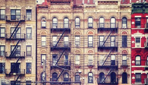 Foto op Plexiglas New York City Vintage stylized picture of old buildings with fire escapes, one of New York City symbols, USA.