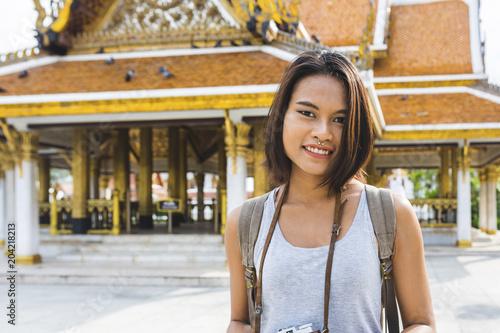 Thailand, Bangkok, portrait of smiling tourist with camera