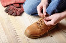 Carpenter In Blue Jeans Tying ...
