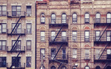 Old buildings with fire escapes, one of the New York City symbols, color toned picture, USA. - 204223225
