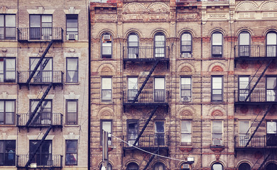 FototapetaOld buildings with fire escapes, one of the New York City symbols, color toned picture, USA.
