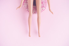 Flat Lay Of Doll Sitting On Do...