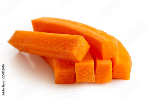 Pile of carrot sticks isolated on white.