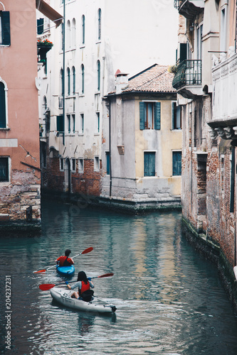 Poster peoples with kayak along waterways in venice