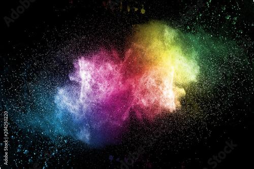 Valokuva  Explosion of multicolored dust on black background.