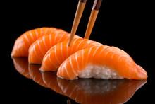 Salmon Nigiri Sushi On The Bla...