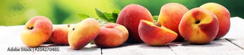 Fototapeta A group of ripe peaches on table