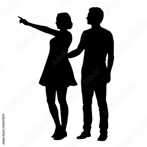 Valokuva  Vector silhouette of boy and girl standing together and pointing finger
