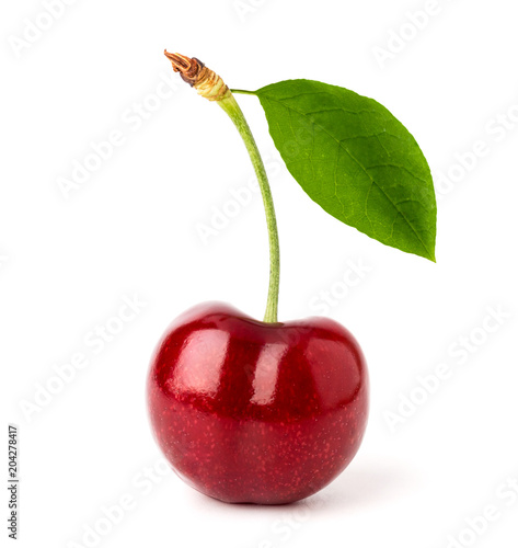 Foto Ripe red cherry with leaf close-up on a white background.