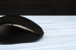 copy spaсe, computer mouse on a blue wood table with a dark background