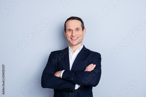 Portrait of cheerful, caucasian, smiling man in formal wear, having his arms cro Canvas-taulu
